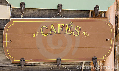 Ancient sign of a french coffeehouse