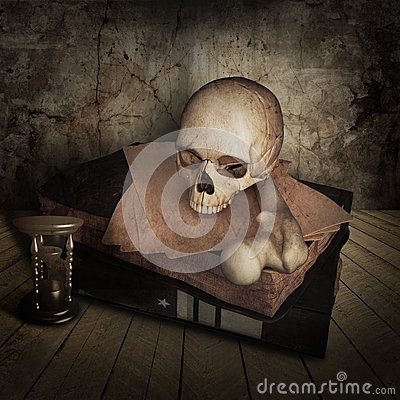 Ancient skull with books