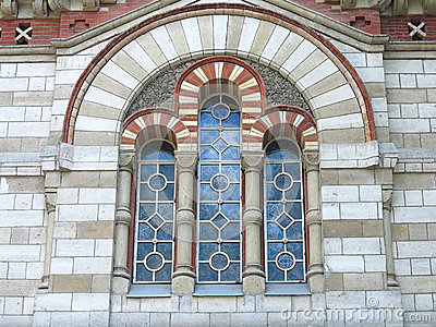 Ancient tall gothic stained glass window