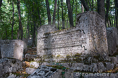 Ancient tombstones in the woods