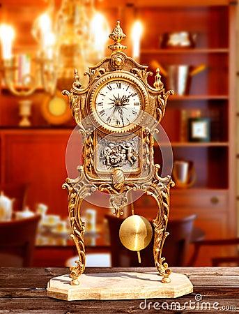 Ancient vintage brass pendulum clock