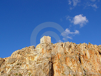Ancient watchtower against sky