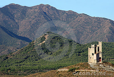 Ancient water tower and mountains in Spain