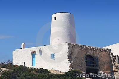 Ancient white salt windmill Formentera