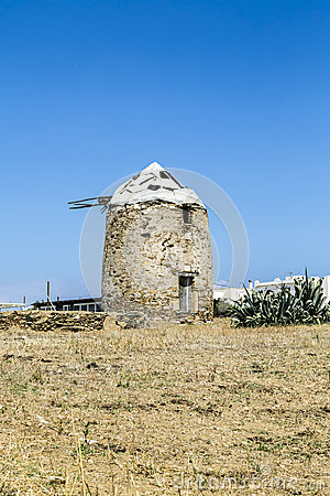 Ancient wind mill in greece, isolated on blue sky
