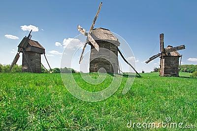Ancient windmills in field