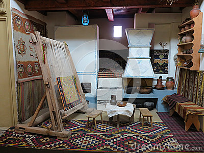 Ancient wooden vintage loom producing carpet