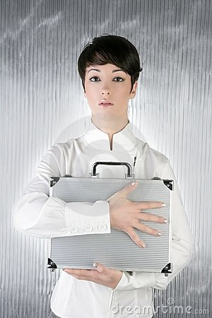 Androgynous woman holding silver briefcase