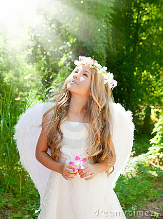 Angel children girl in forest with flower in hand