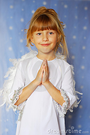 Angel girl with hands  folded  to the prayer