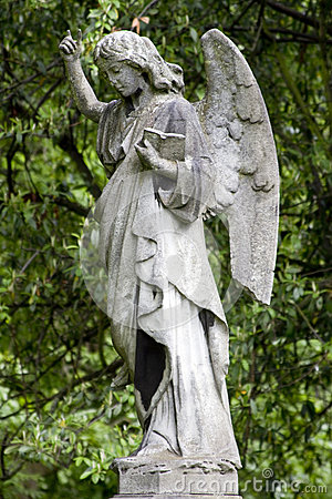Angel with hand raised and bible