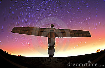 Angel of the north at night with star trails