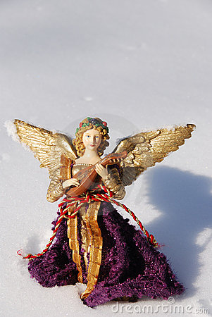 Angel ornament in snow