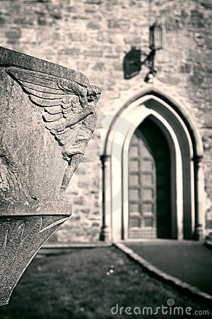 Free Angel Sculpture Looking Over Church Entrance Stock Images - 8637294