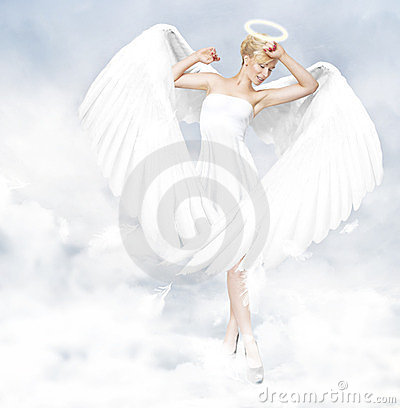 Angel standing in clouds
