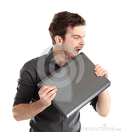 Angered office manager bites the laptop