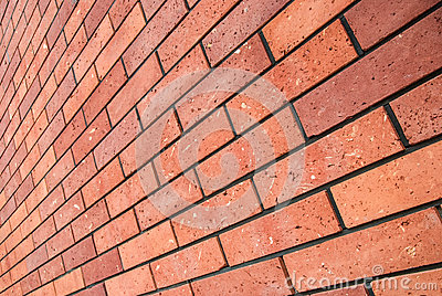 Angle view red brick wall