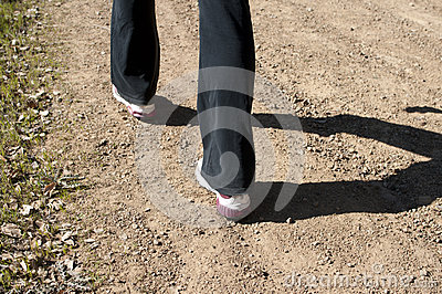 Angled close up of woman s feet hiking in black pants