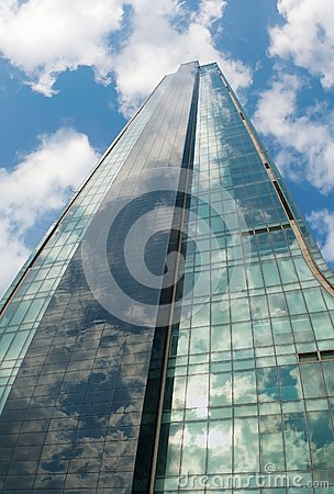 Angled view of a glass wall of an office building