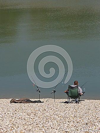 Free Angler Enjoying Peace At Lake Shore Royalty Free Stock Images - 1317279