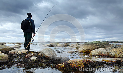 Angler on sea coast