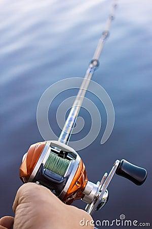 Angler use multiplier fishing reel