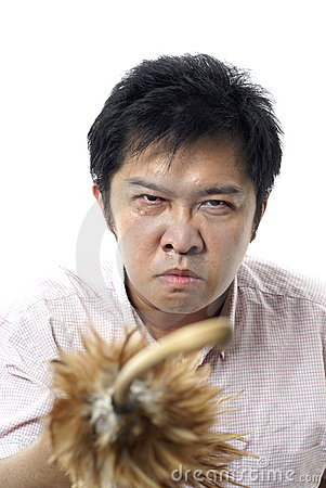 Angry asian with feather cane