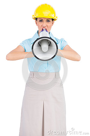 Angry attractive architect shouting in megaphone