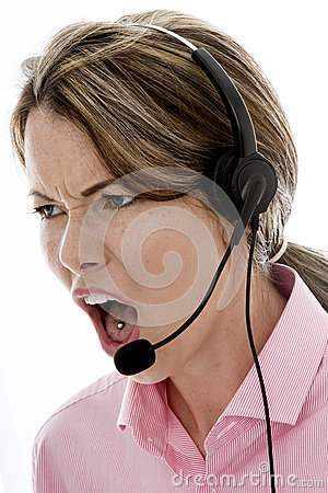 Free Angry Attractive Young Business Woman Using A Telephone Headset Stock Photography - 60600142