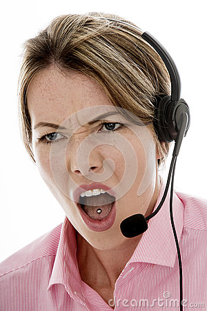 Free Angry Attractive Young Business Woman Using A Telephone Headset Stock Image - 60600211