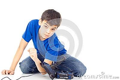 Angry boy throws joysticks