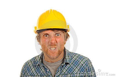 Angry builder in hard hat