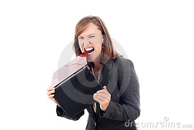 Angry business woman biting laptop