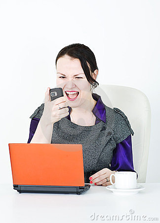 Angry business woman screaming with phone