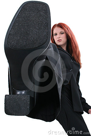 Free Angry Business Woman Stomping Out The Competition Royalty Free Stock Image - 149906