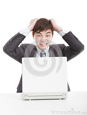 Angry businessman with a laptop