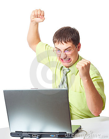Angry businessman with laptop