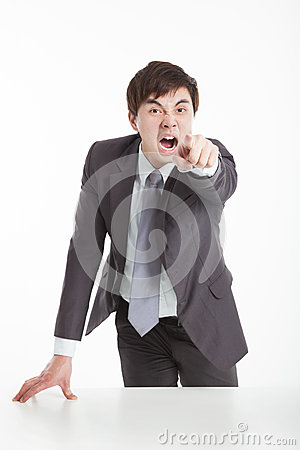 Angry businessman pointing camera
