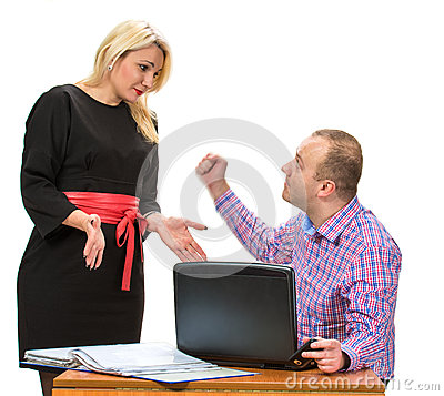 Angry businessman shouting at his assistant