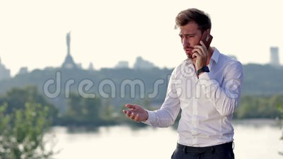 Angry businessman shouting on the phone stock footage