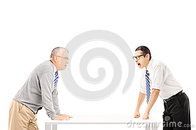 Angry businessman shouting at senior man