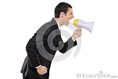 Angry businessman shouting via megaphone