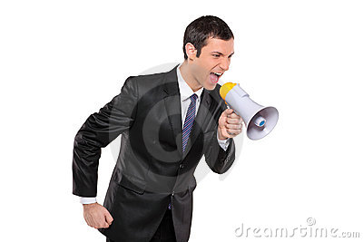 An angry businessman shouting via megaphone