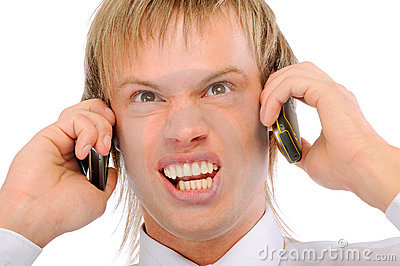 Angry businessman shouts in two phones