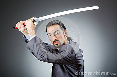 Angry businessman with sword