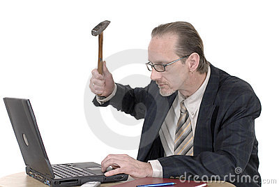 Angry Businessman working on laptop