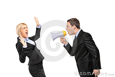Angry businessman yelling via megaphone to a woman