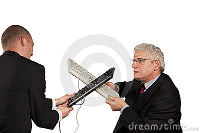 Angry businessmen fighting with keyboards
