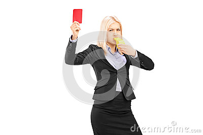 Angry businesswoman blowing a whistle and showing a red card