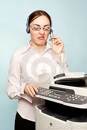 Angry businesswoman with copier